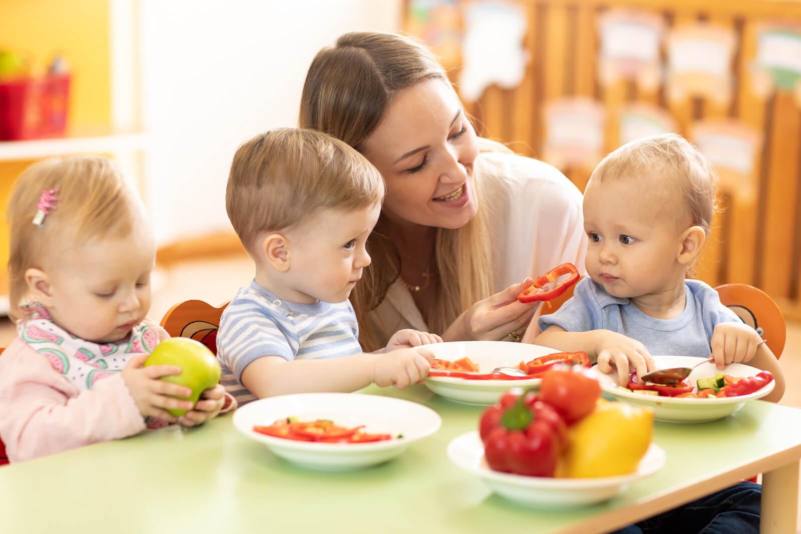 bigstock Babysitter Feeding Nursery Bab 291122821