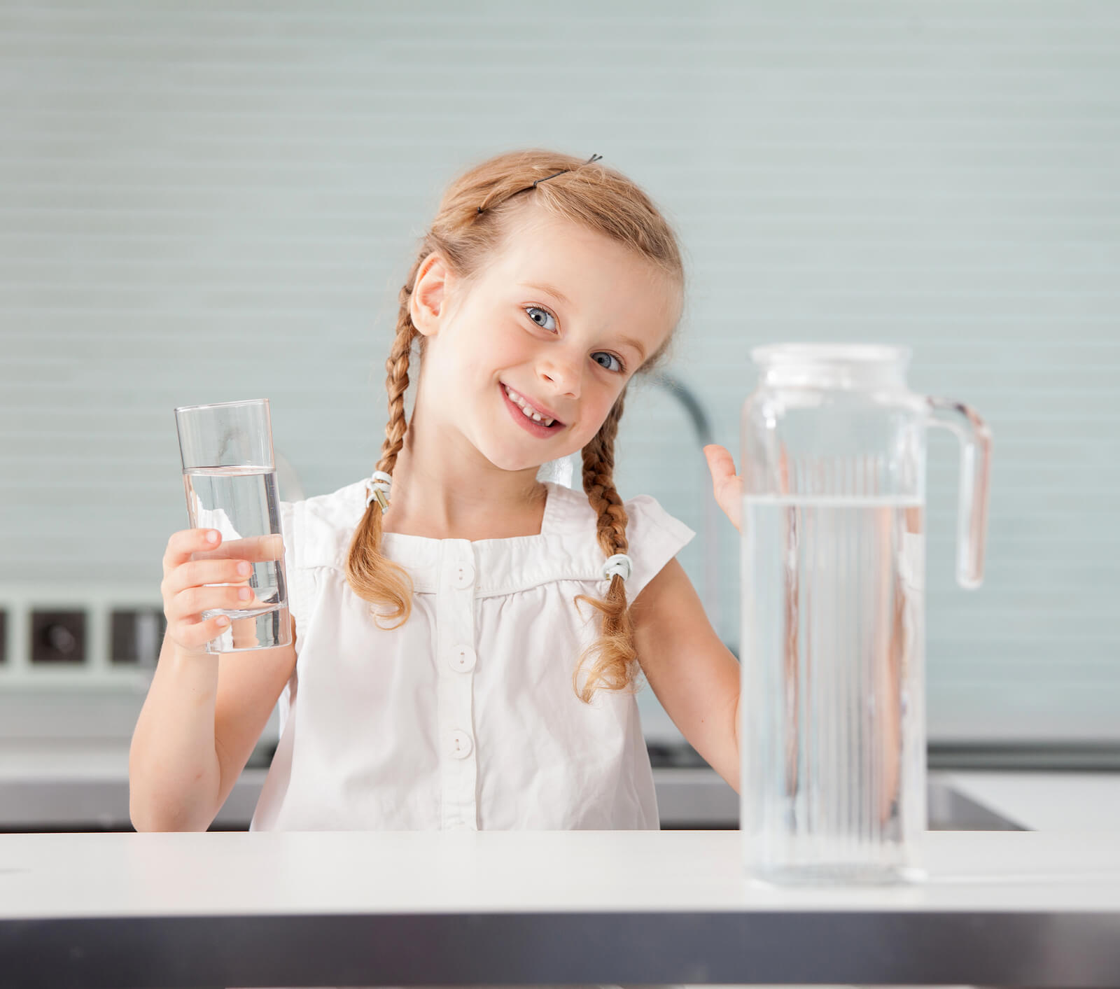 bigstock Child drinking water from glas 282220516