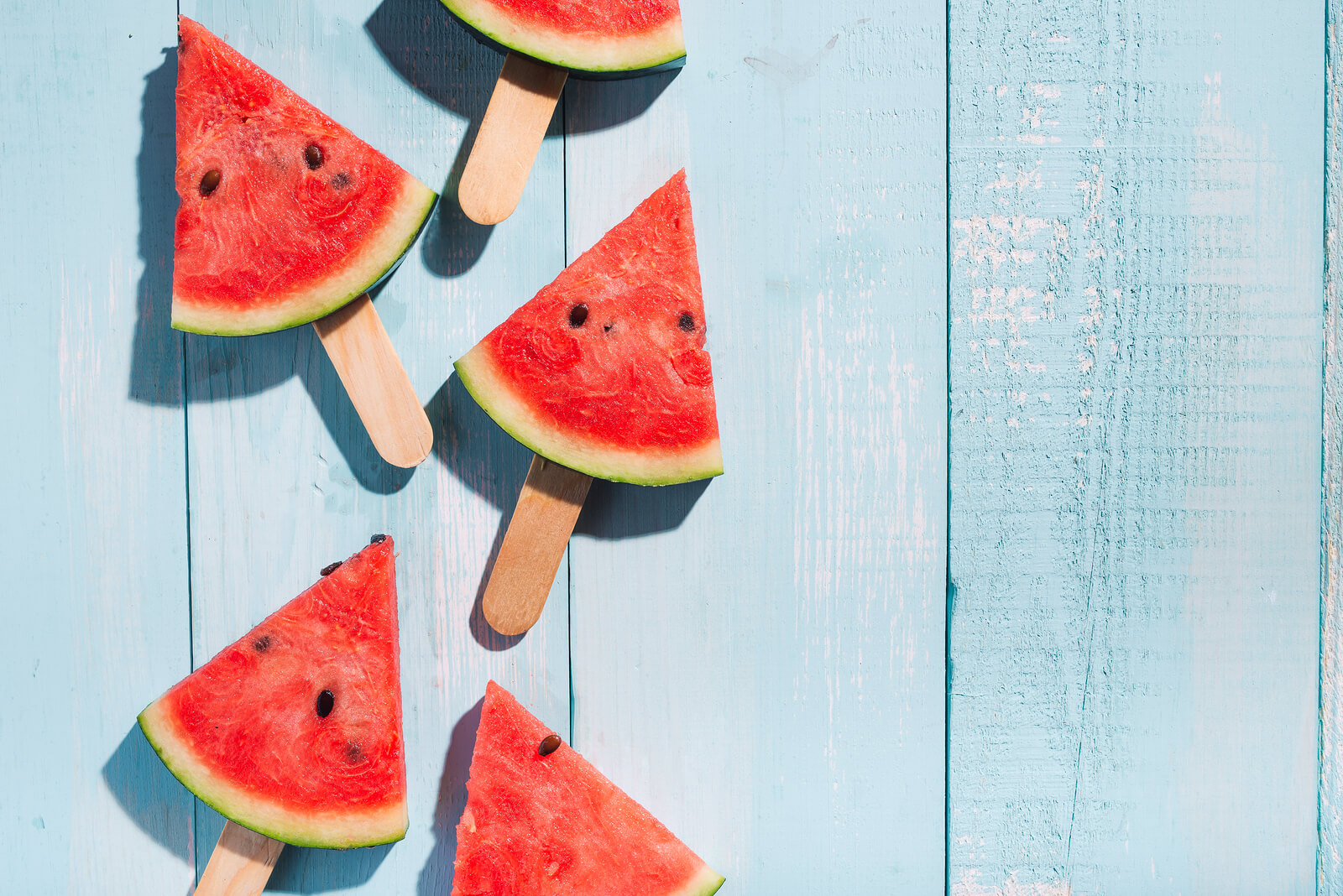 bigstock Slices Of Watermelon On Blue W 242057263