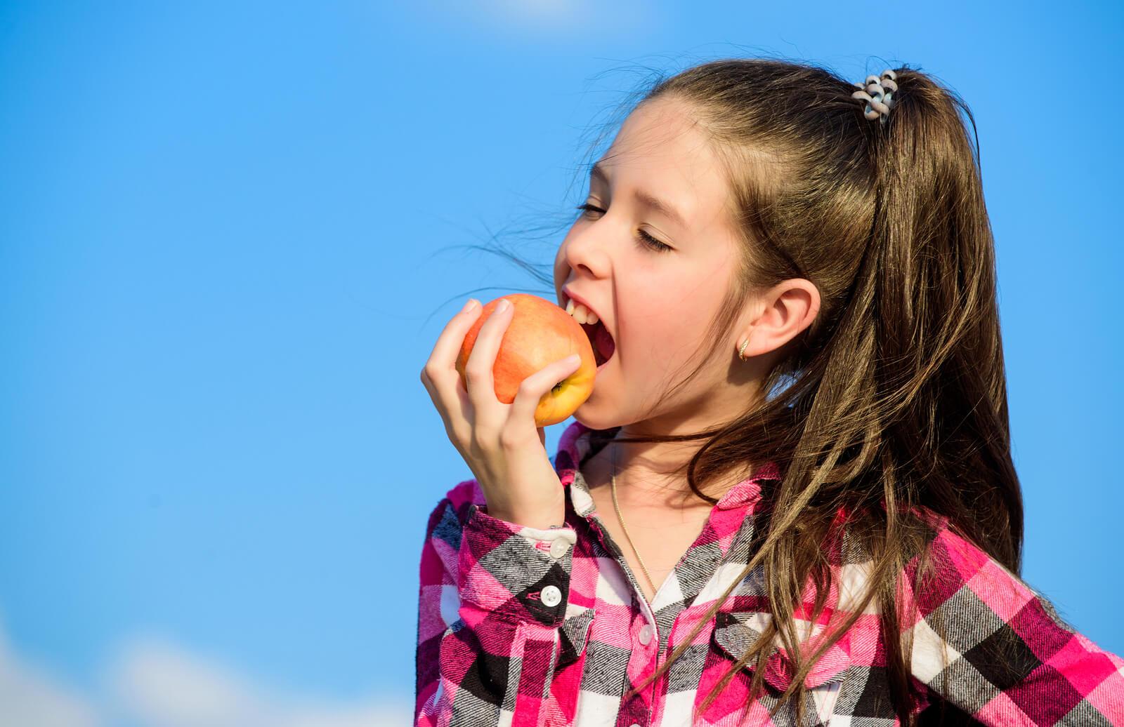 bigstock Apple Fruit Diet Kid Hold Rip 266534206